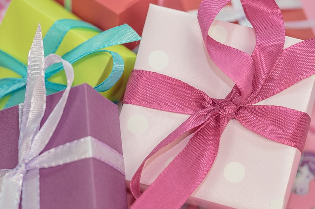 gift boxes with bows in pink green and white