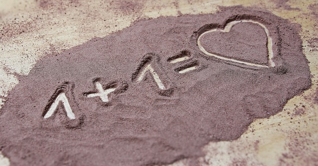 one plus one equals love drawn in the sand