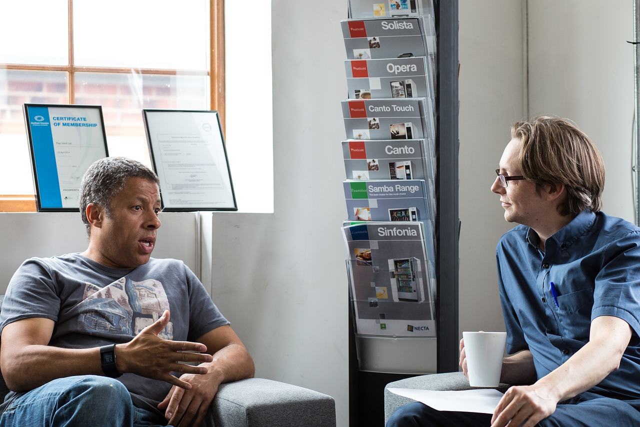 two men talking and active listening