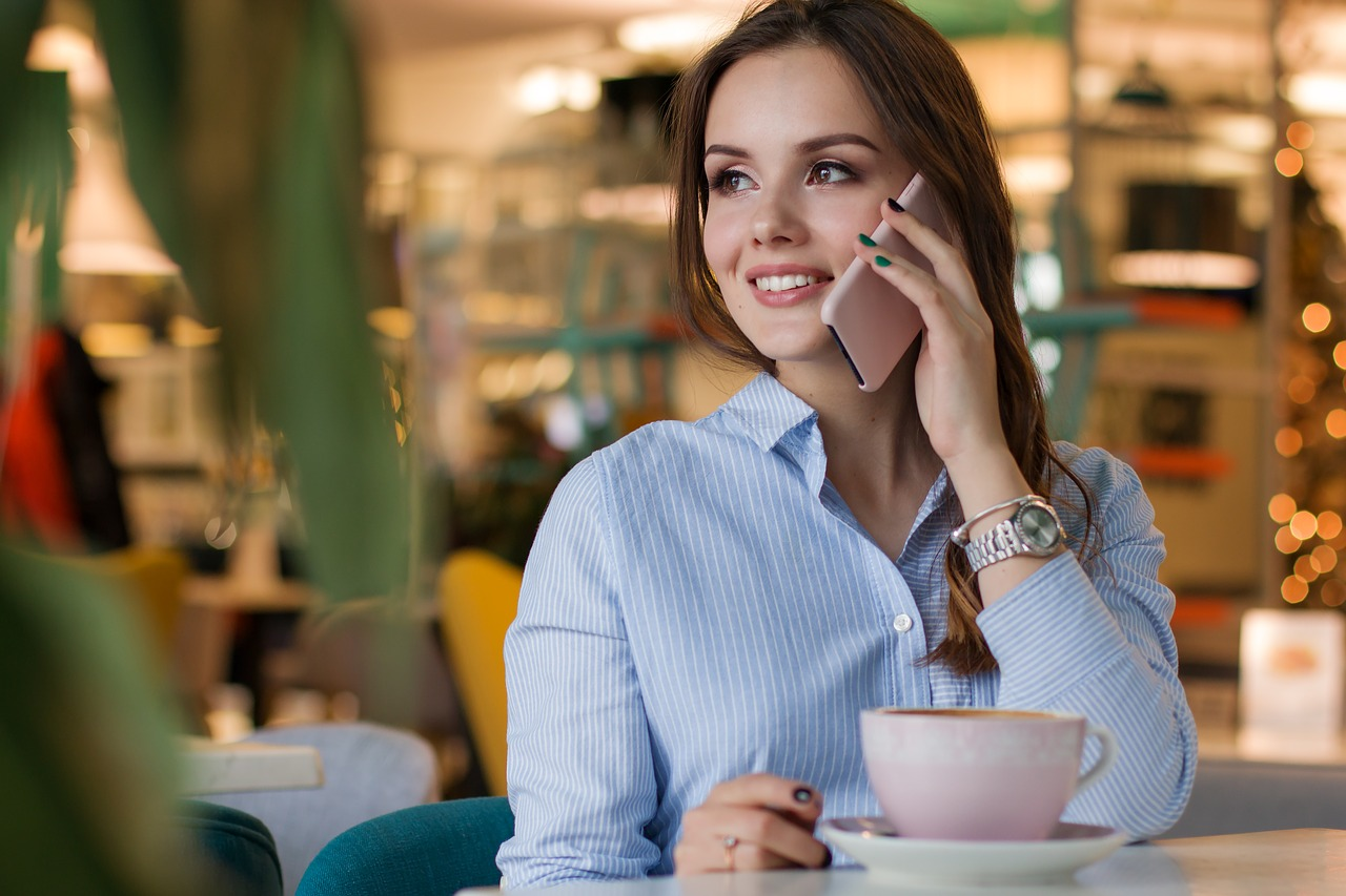 woman on cell phone smiling attitude self motivation steps