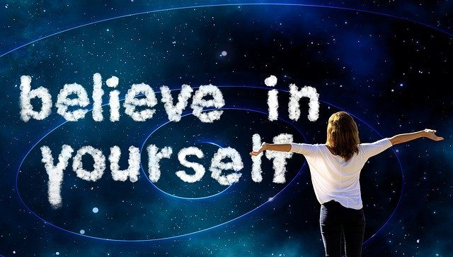 believe in yourself written in white on blue sky improve your personal development