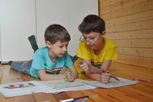 two young boys in class home schooling options child's leadership skills