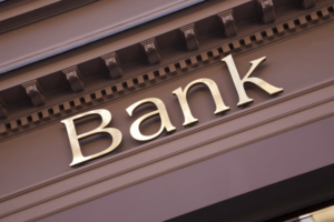 bank sign on building growing a savings account