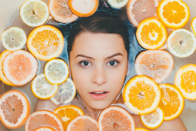 Filipino Skincare Claims woman face surrounded by orange lemon slices