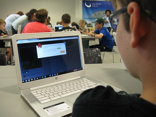 trachers in a class with students on laptops public speaking skills