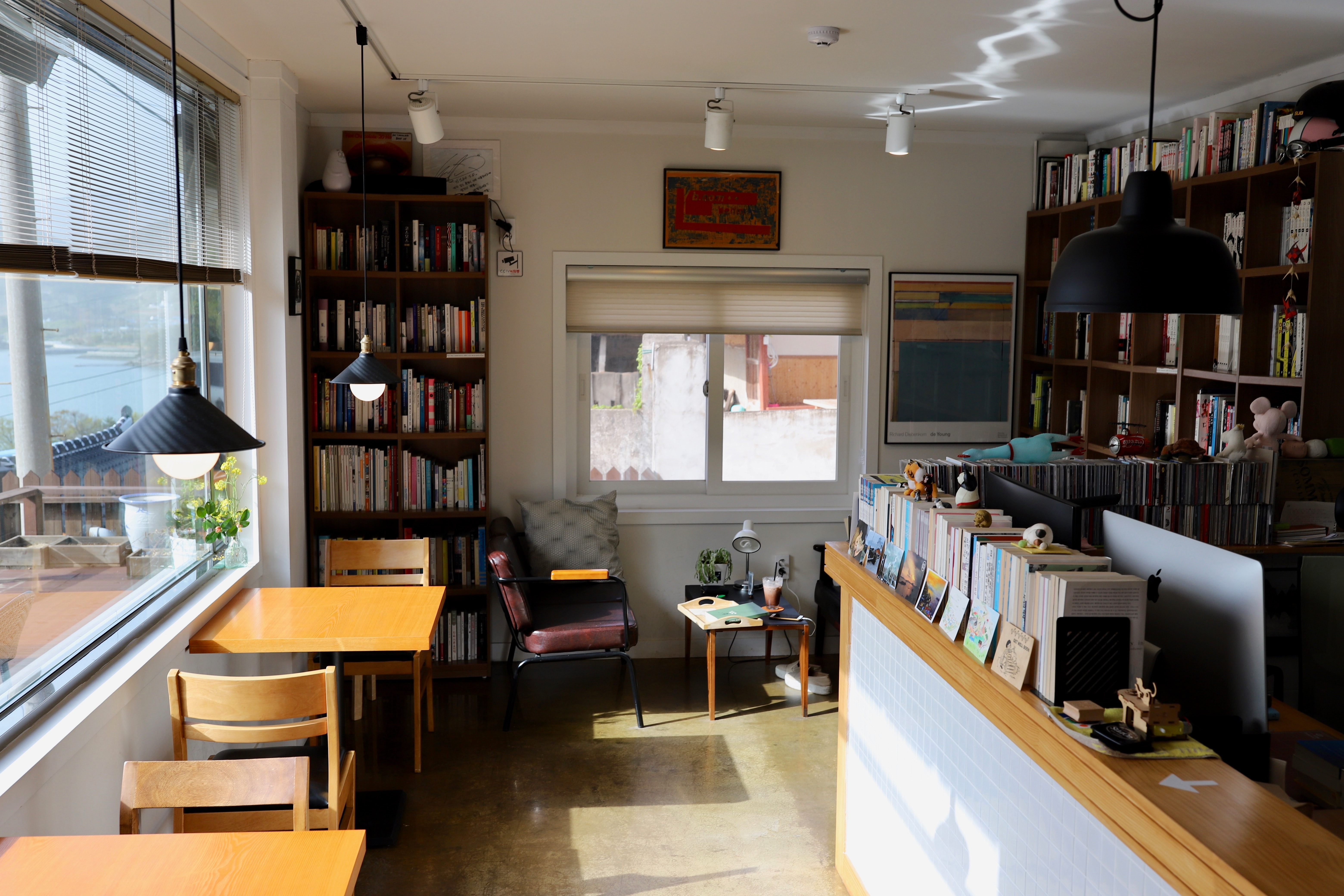 small home library with books on shelves everywhere