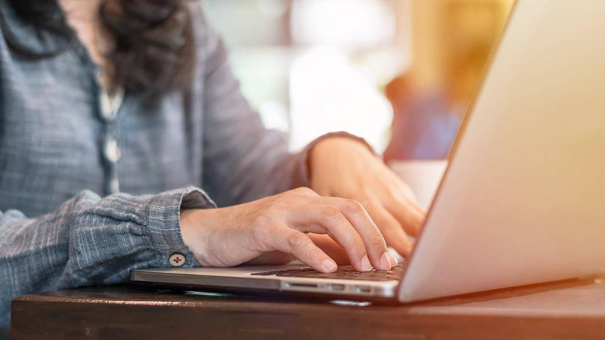 woman typing on open laptop proven time management tips