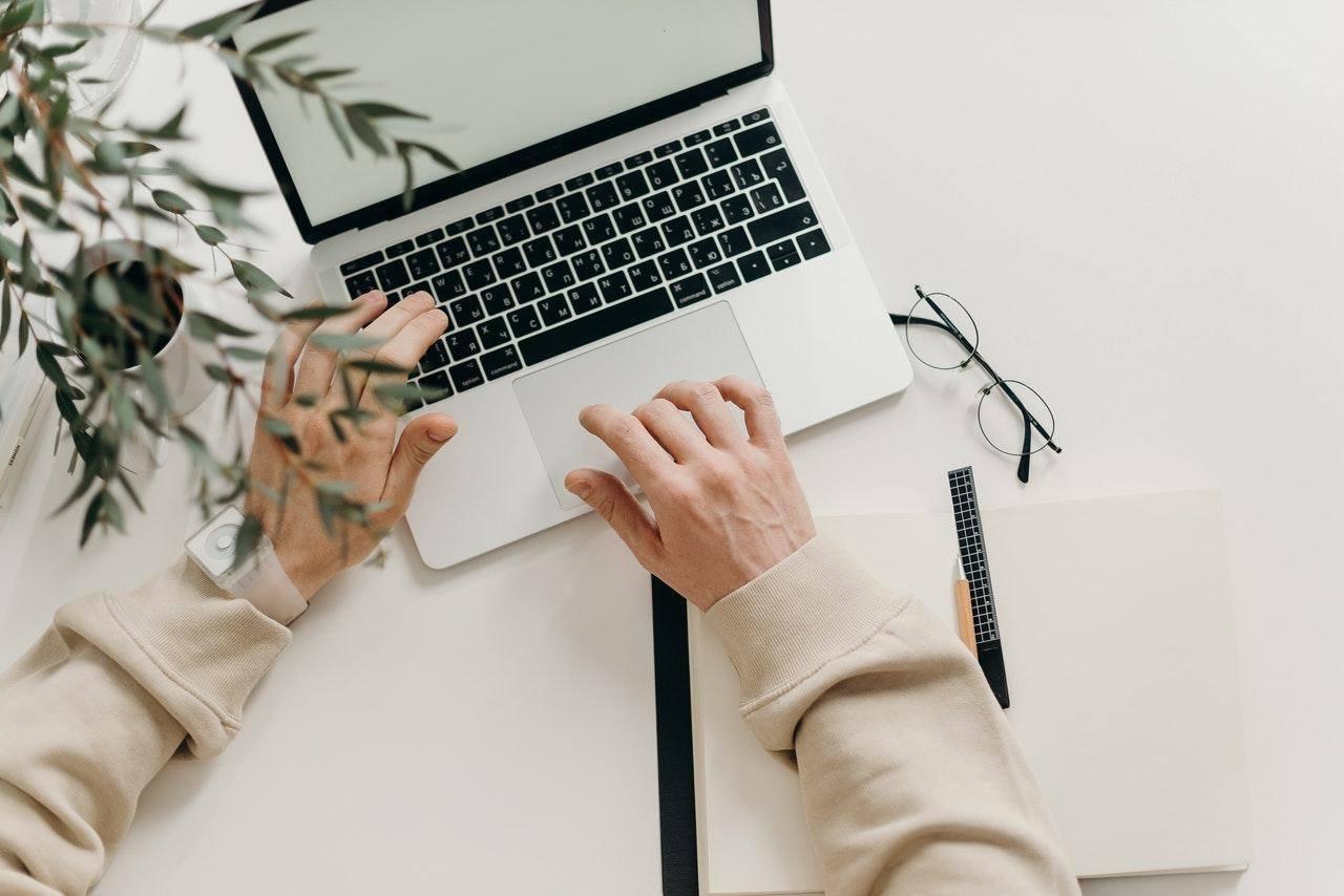 fingers on open laptop keyboard